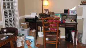 Before: My messy home office.  Notice the piles of clutter in front of the filing cabinet.  Just a bit ironic!